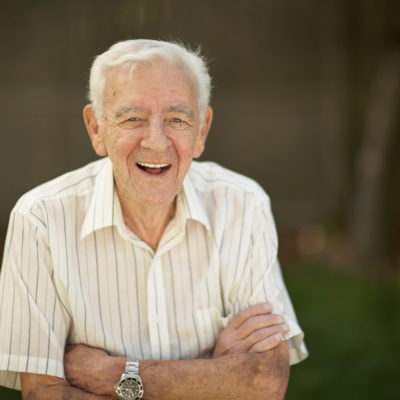 Elderly man smiling at his home health care nurse